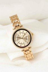 Gold Renk Metal Kordonlu Zirkon Taşlı İç Tasarımlı Clariss Marka Bayan Kol Saati